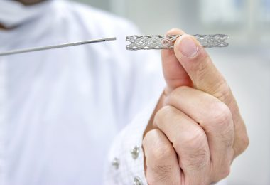 Doctor holding cardiac catheterization and heart stent
