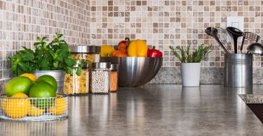 Kitchen counter with fresh fruit and spices.