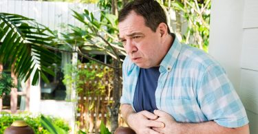 Mature man with stomach pain