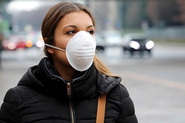 Woman wearing mask on street