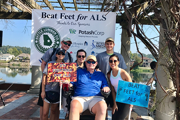 Man with ALS with family