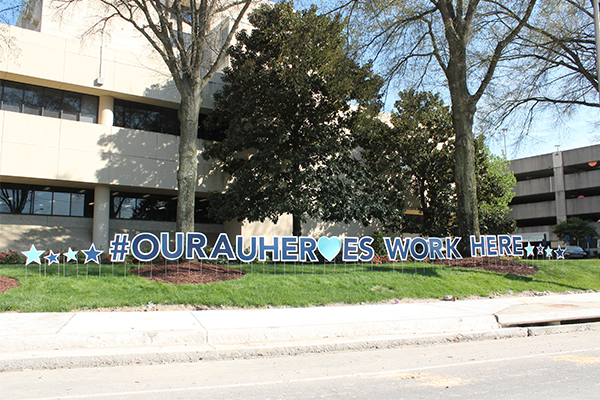 Our AU Heroes signage