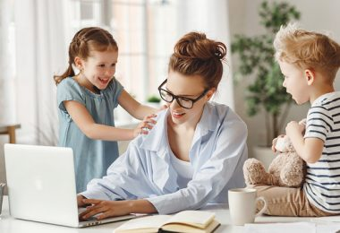 Mother working from home with kids