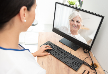 Old Caucasian lady using telehealth for doctors visit