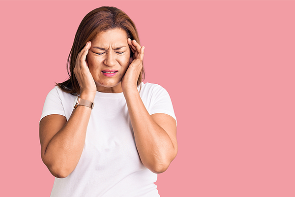 Older Hispanic woman having a headache