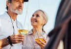 Older man and woman drinking wine