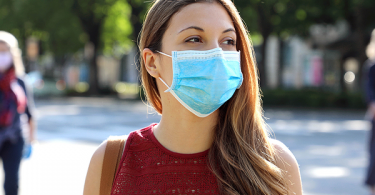 Woman wearing mask outside and socially distanced