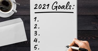 Man writing down 2021 goals