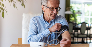 Older male taking blood pressure