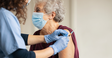 Elderly woman getting vaccinated