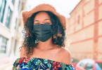 Black woman wearing a mask
