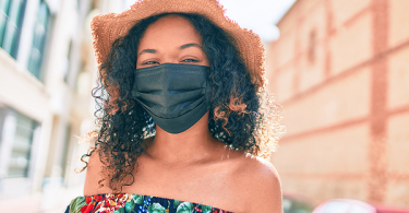 Black woman wearing a mask