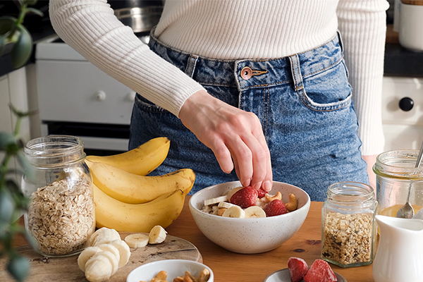 Woman eating foods with potassium