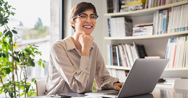 Woman smiling and working from home