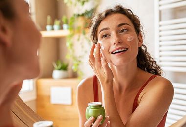 Woman taking care of skin at home